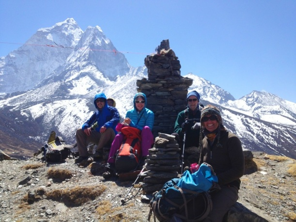 A well-earned rest at the top of La Jung. (Left to right: Mingma Nuru Sherpa (behind), one of our guides Peter, Viki, Martin  and Julie).